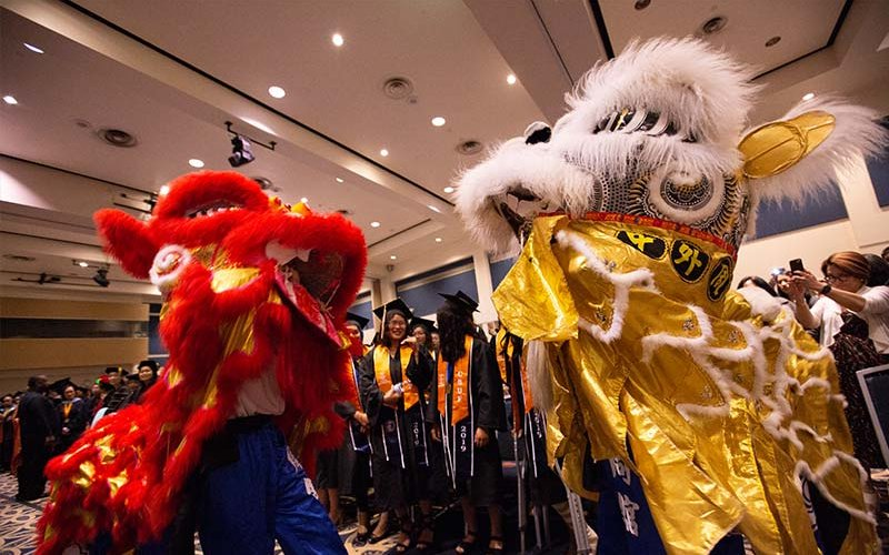 The TYT Lion group performs the Dragon Dance for the 17th Annual APIDA Graduation Recognition Ceremony.