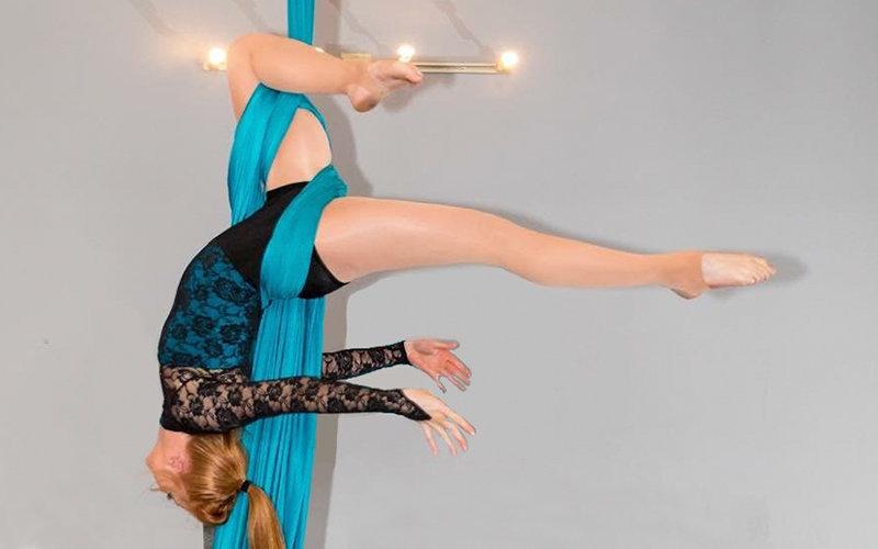 Woman performing aerial acrobatic move.