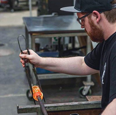 Alex Dixon working on glass art.