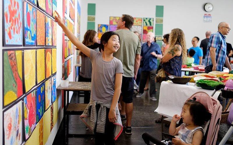 Art Camp Children interacting with art.