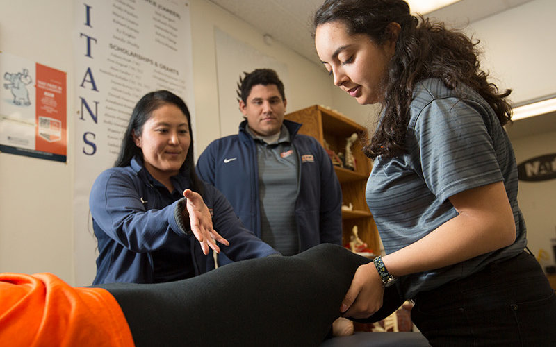 Athletic Trainers work on a patient.