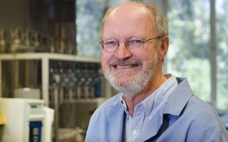 Nobel Laureate in chemistry Robert H. Grubbs, man smiling in laboratory