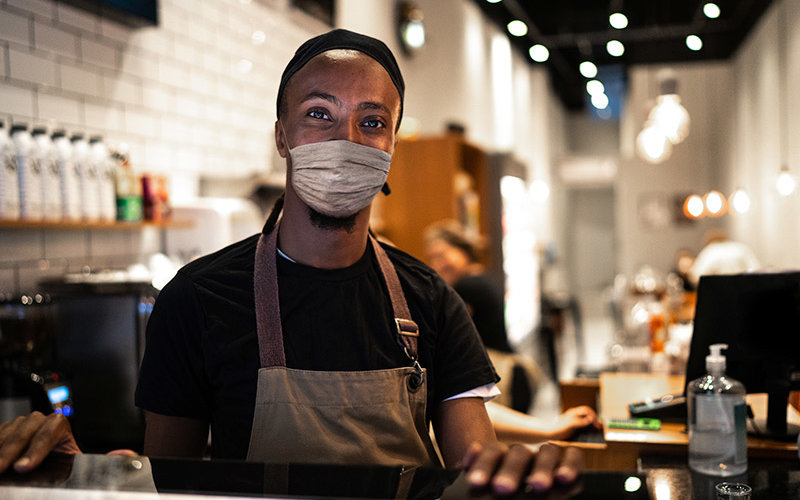 Small business owner with covid-19 mask.