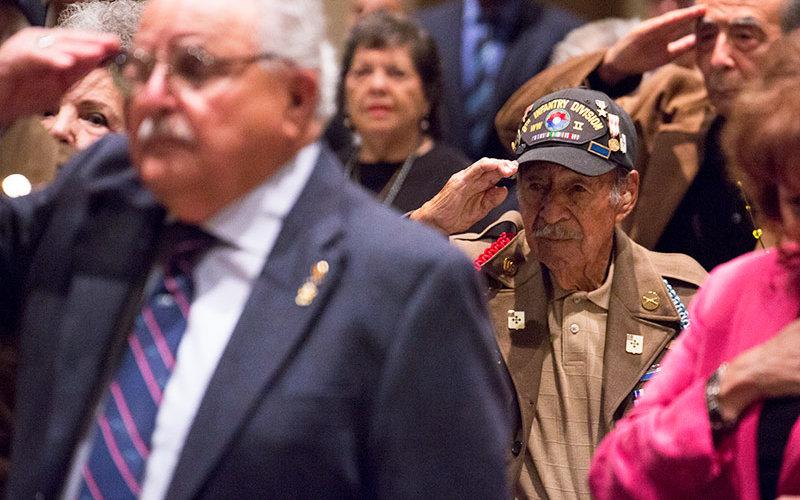 Veterans saluting.