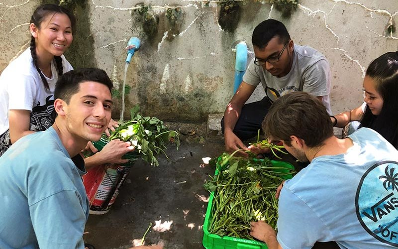Students with vegetables