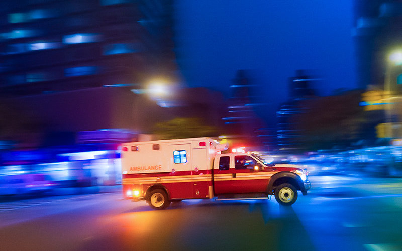 Ambulance speeding at night on an urgent call