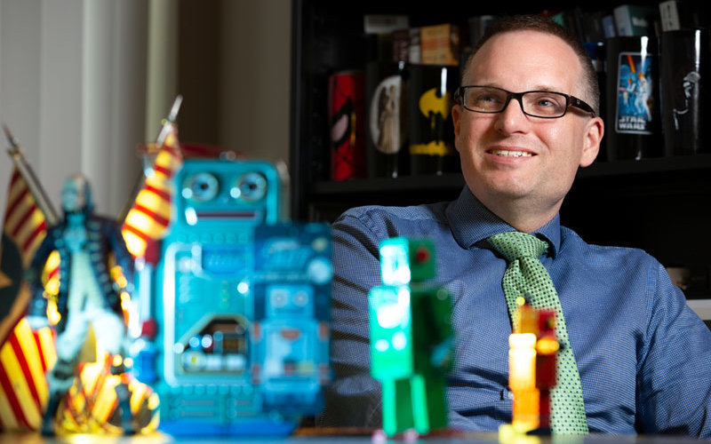 Robotic researcher Dustin Abnet with robots.