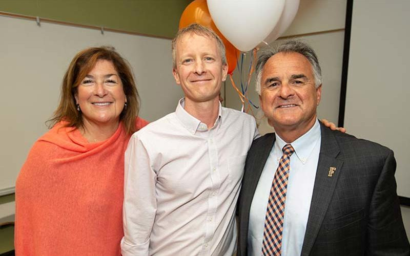 Professor Matt Englar-Carlson with President Virjee & Julie Virjee