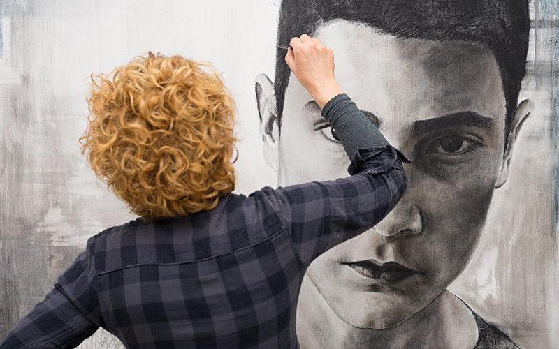 Female artist making art