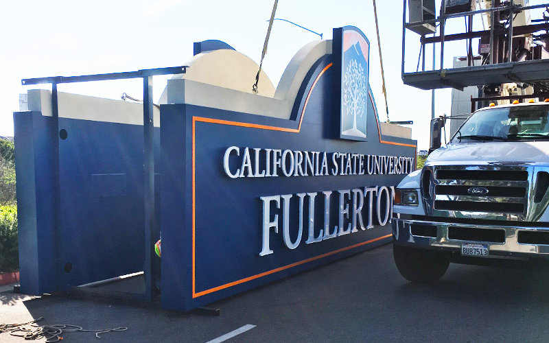 Freeway sign being prepared to be installed.
