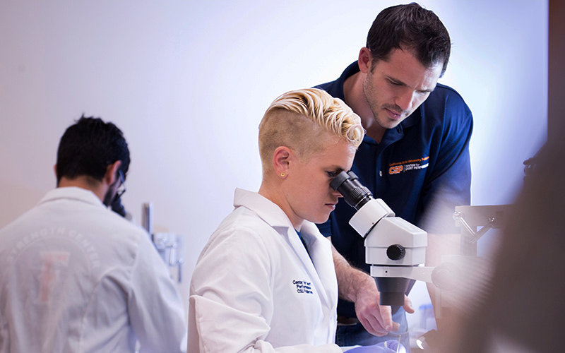 Andy Galpin and student researcher in lab.