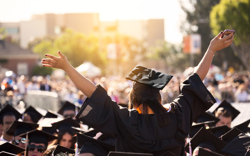 Graduate celebrating