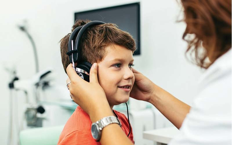 Child receives hearing screening test