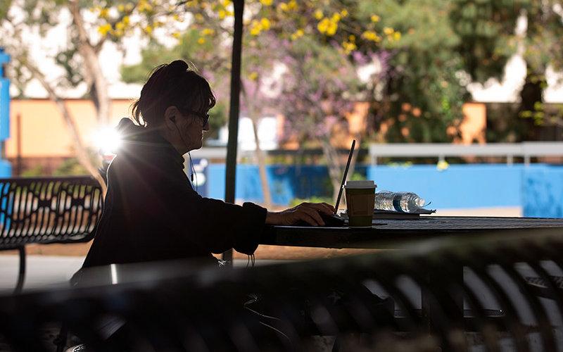 Heather Paredez works on her CSUF laptop.