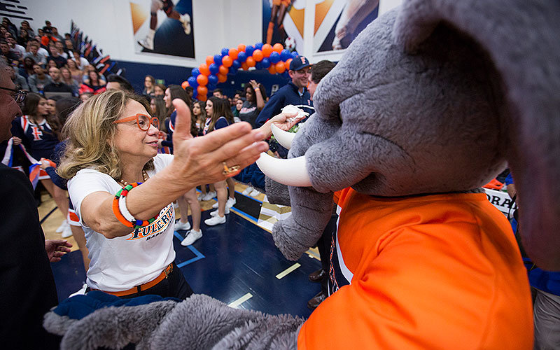 President Mildred Garcia greeting Tuffy at Homecoming.