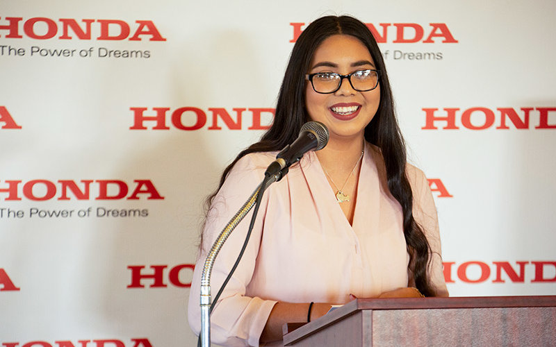Jaylene Mendoza speaks at the Hispanic Golf Tournament.