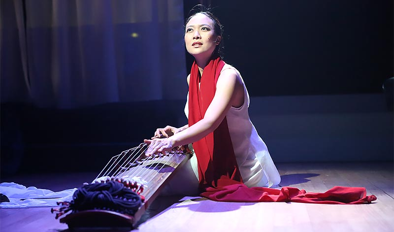 Jen Shyu performing on stage.