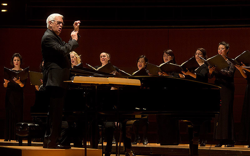 Conductor John Alexander leads a performance with the University Singers.