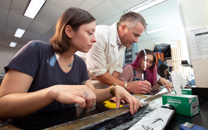 Professor Matthew E. Kirby works with students on paleoclimate research.