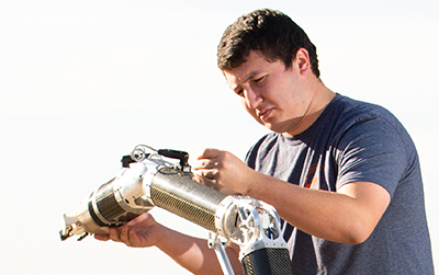 Louis Vest works on Rover arm.