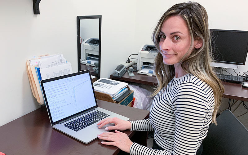 MARC Researcher Kendra Paquette works on her cpmputer.