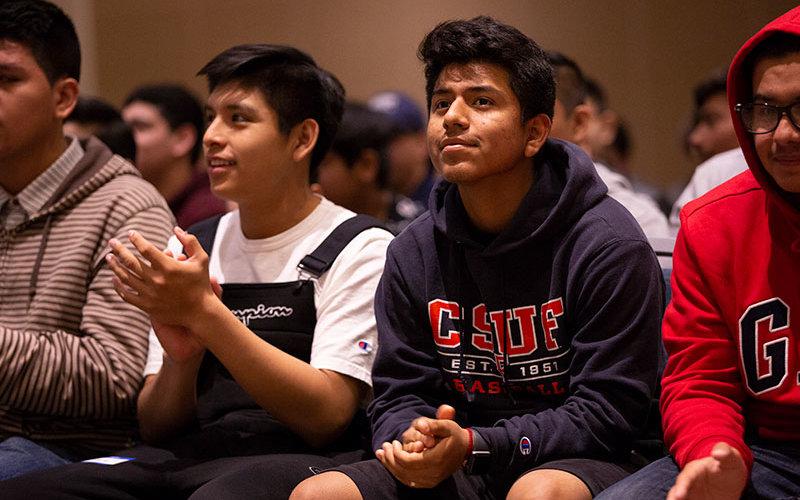 High School Student Adrian Basilio listens to panelists.