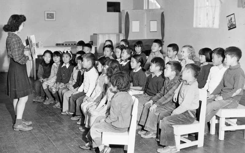 Students with teacher in Manzanar library.