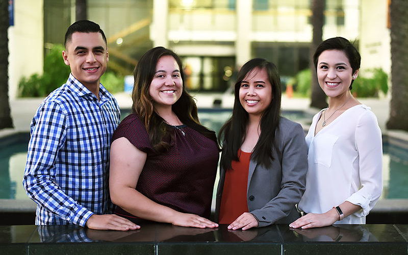 Graduate students standing in front of Langsdorf Hall. Michael Yepez, from left, Esmeralda Trejo, Shannen Allado and Kenitza Carrillo