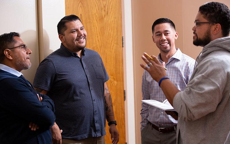 Members of the Men of Color in Education Program talk.