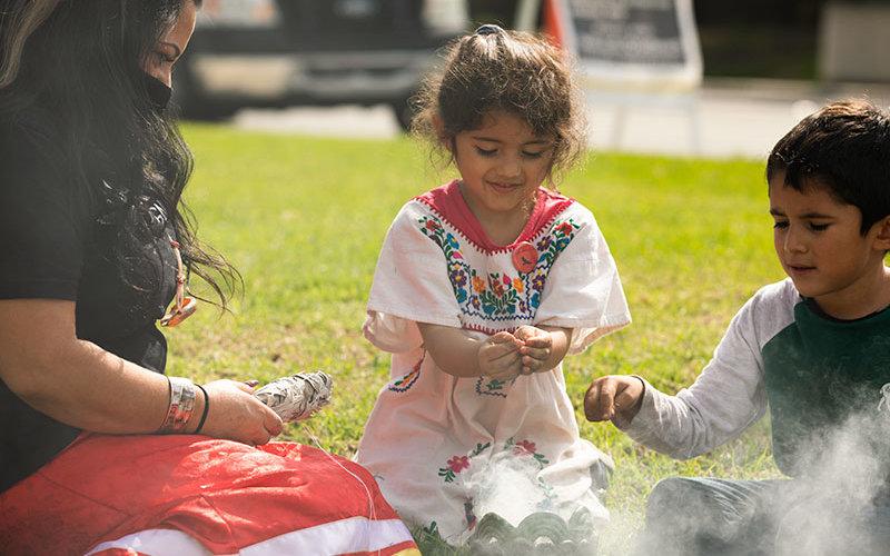 Native Claifornians perform sage ceremony.