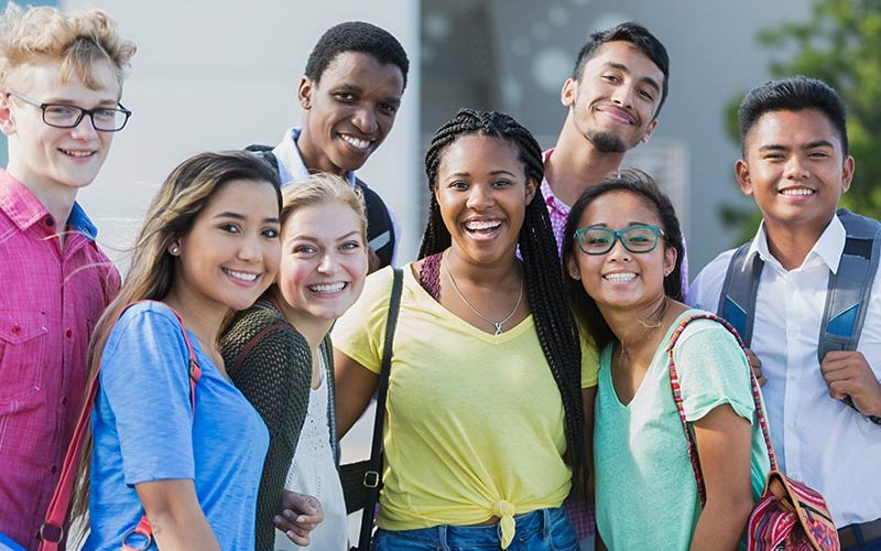 Diverse high school immigrant students learning language.