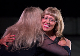 Norma Morris hugged by Maria Hall-Brown of PBS Socal