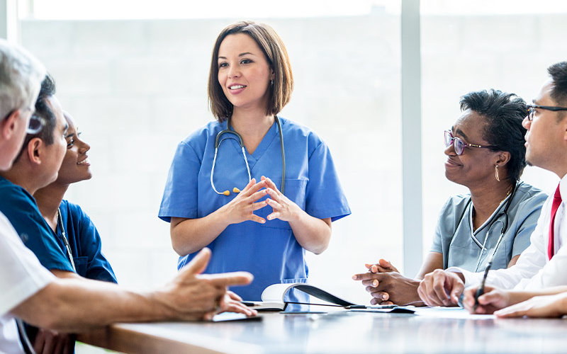 Nurse works with large group.