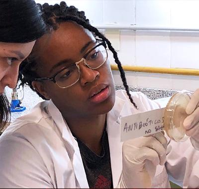 Nyah Rodman looks at bacteria sample.