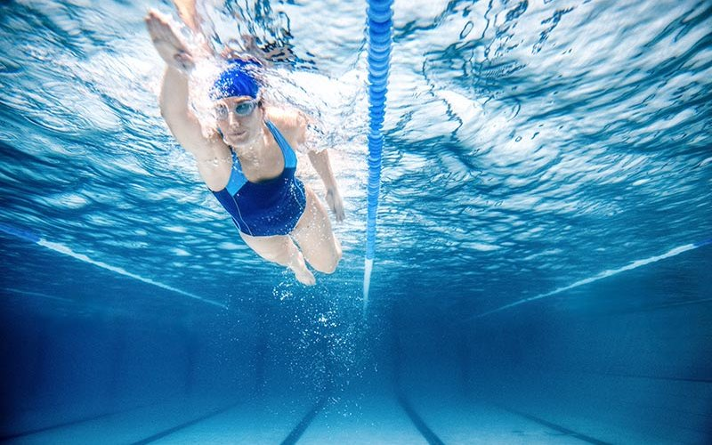 Olympic swimmer in pool training.
