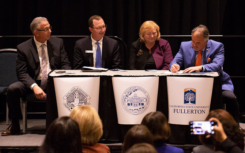 Educational Partners sign agreement.