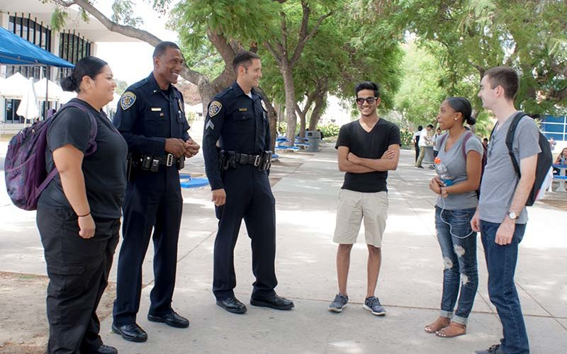 UPD Officers speak to students on campus