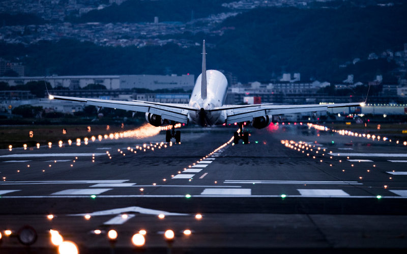 A plane lands at an airport.