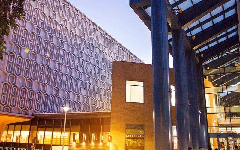 Pollak Library at twilight.