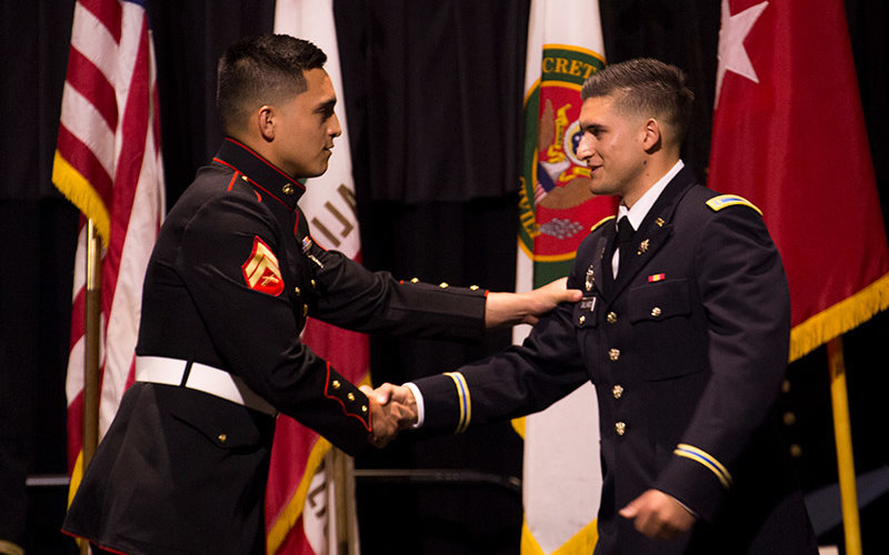 ROTC cadet shakes hands with a friend