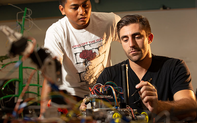 Engineering students work on their seeing-eye robot.
