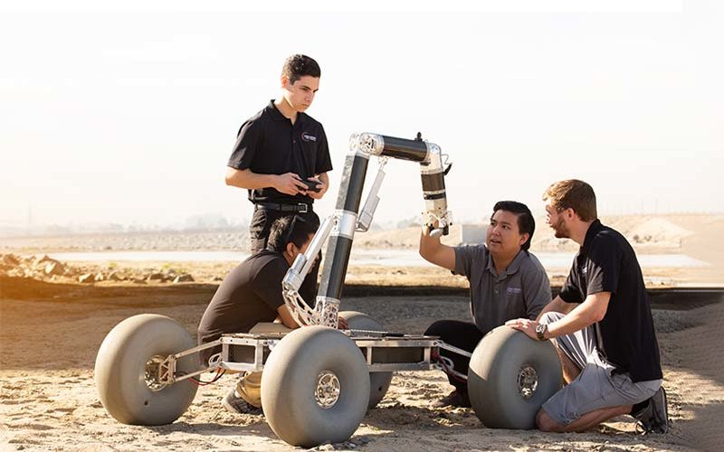 Engineering students working on Rover.