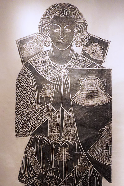 Large rubbing of a knight in armor.