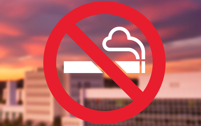 Smoking Ban illustration over campus.