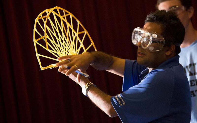 Binod Tiwari-man-shows student Spaghetti Bridge
