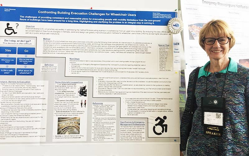 Sue Fisher with Poster presentation board
