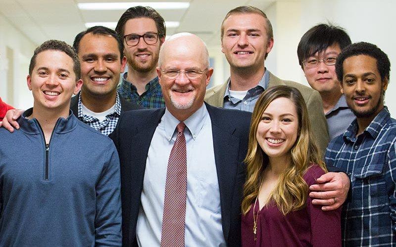Jeffrey Van Harte with students