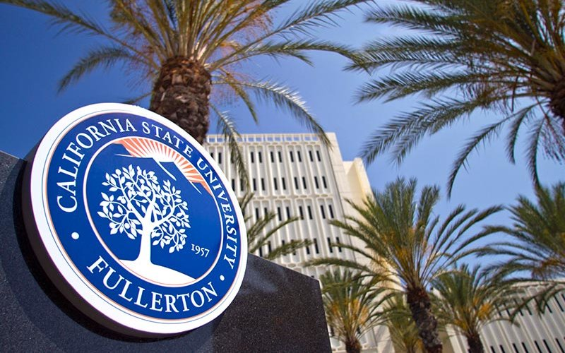 CSUF seal monument with Langsdorf Hall in the background