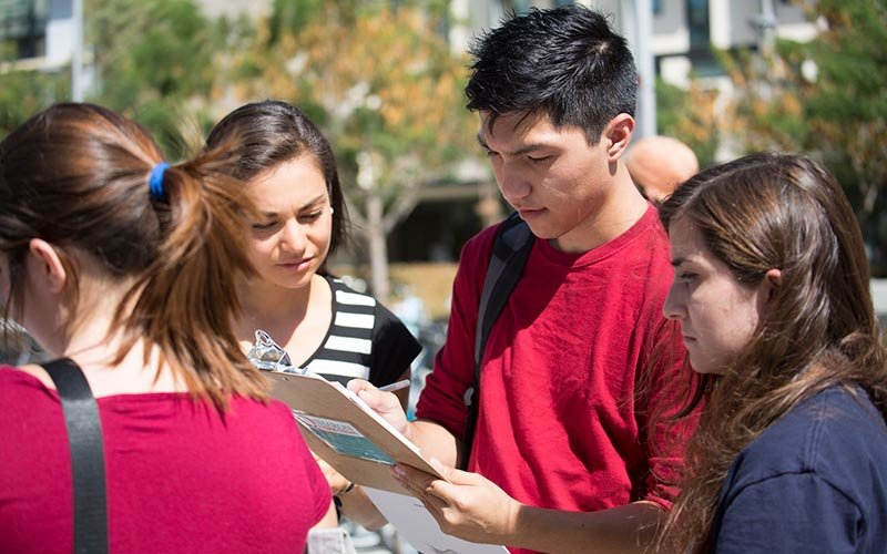 Students sign up on National Voter Registration Day.
