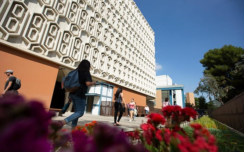 CSUF Library with students walking.